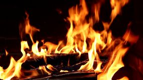 Closeup of fireplace full of wood and fire stock video footage