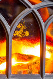 Closeup of fireplace with orange fire flame interior. Heating. Stock Photo