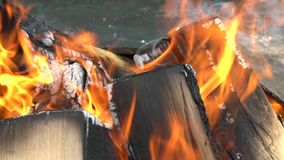 Closeup of firewood burning slowly with orange fire flame. Slow motion shot. Closeup of firewood burning slowly with orange fire flame in cozy fireplace stock video footage