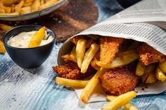Closeup of Fish & Chips served in the newspaper Stock Image