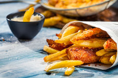 Closeup of Fish & Chips served in the newspaper Royalty Free Stock Photography