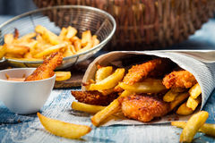 Closeup of Fish & Chips served in paper Stock Images