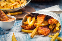 Closeup of Fish & Chips served in paper Royalty Free Stock Photos