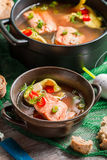 Closeup of fish soup spiced with dill and chilli pepper Royalty Free Stock Images