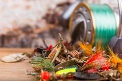 Closeup fishing baits lures with reel Stock Photos