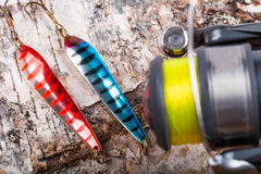 Closeup fishing baits lures with reel Royalty Free Stock Photography