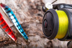Closeup fishing baits lures with reel Stock Photography