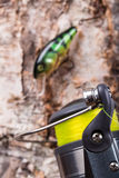 Closeup fishing baits wobblers with reel Stock Photography