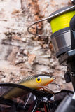 Closeup fishing baits wobblers with reel Royalty Free Stock Photography