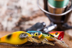 Closeup fishing baits wobblers with reel Royalty Free Stock Images
