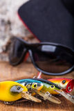 Closeup fishing baits wobblers with sunglasses Stock Image