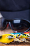 Closeup fishing baits wobblers with sunglasses Stock Images