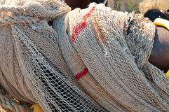 Closeup of fishing nets hanging to dry in the sun Royalty Free Stock Images
