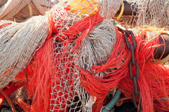 Closeup of fishing nets hanging to dry in the sun Royalty Free Stock Photos