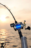 Closeup for fishing-rod at sunset Stock Photo
