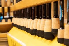 Closeup of fishing rods lined up for sale in a popular sporting goods retailer stock photos