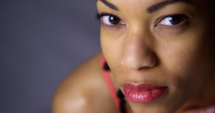Closeup of fit African woman looking at camera Stock Photos