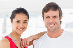 Closeup of a fit smiling couple in exercise room Royalty Free Stock Photos