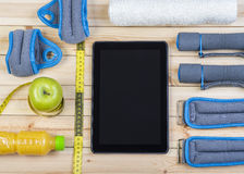 Closeup Of Fitness Equipment And Healthy Nutrition. Sport Equipment. Dumbbells,  Ankle Weights, Wrist Weights, Towel, Tape Measure, Apple, Orange Juice And Stock Photography