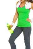 Closeup on fitness woman with bottle of water Royalty Free Stock Photos