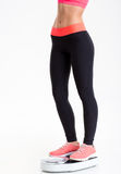 Closeup of fitness woman legs standing on weighing scale Stock Photography