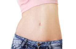 Closeup on fitness woman showing flat belly Royalty Free Stock Image