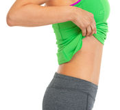 Closeup on fitness woman showing flat belly Royalty Free Stock Images