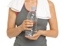 Closeup on fitness young woman with bottle of water Stock Image