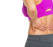 Closeup on fitness young woman having backache Stock Photo