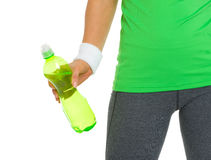 Closeup on fitness woman holding bottle of water Royalty Free Stock Photo