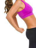 Closeup on fitness young woman showing biceps Stock Image