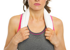 Closeup on fitness young woman with towel Stock Photos