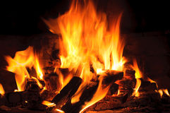 Closeup of Flame in a fireplace, flames and burning woods Royalty Free Stock Photo