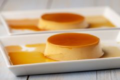 Flan. Closeup of flan dessert on plates Stock Photos