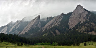 Closeup of Flatiron mountains in Boulder, Colorado. Storm clouds over the Flatiron rock formations, part of the Rocky Mountain foothills just outside Boulder Royalty Free Stock Photography
