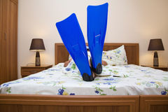Closeup flippers in bed. Closeup flippers in  bed on feet at the man Stock Photography