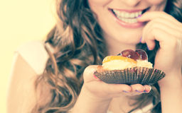 Closeup flirty woman eating fruit cake Stock Images