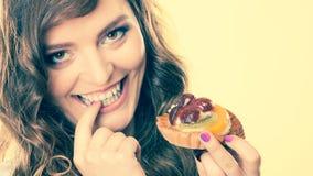 Closeup flirty woman eating fruit cake Royalty Free Stock Images