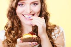Closeup flirty woman eating fruit cake Stock Photo
