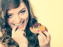 Closeup flirty woman eating fruit cake Royalty Free Stock Photography