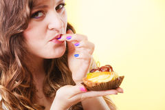 Closeup flirty woman eating fruit cake Stock Photos