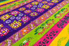 Closeup of floral Lent carpet, Antigua, Guatemala. Antigua, Guatemala - March 13, 2016: Closeup of floral pattern on handmade dyed sawdust Lent carpet for royalty free stock photos