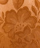 Gold fabric flower texture background royalty free stock image