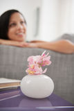 Closeup on flower in a vase and dreaming girl Royalty Free Stock Image