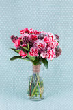 Closeup flowers bouquet in glass vase. Closeup pink carnations bouquet of flowers in vase Stock Photos