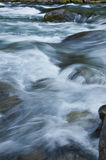 Closeup of flowing water with sea green and blue colors Royalty Free Stock Photos
