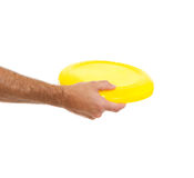 Closeup on flying disc in male hand Stock Photos
