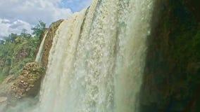 Closeup Foamy Wall of Wide Powerful Waterfall among Rocks. Closeup foamy water wall of wide powerful waterfall among rocks in tropical national park in Vietnam stock video footage