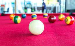 Closeup focus snooker white ball with pool balls Royalty Free Stock Photo