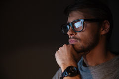 Closeup of focused man in glasses looking at screen Royalty Free Stock Photos